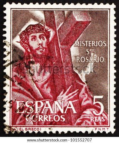 SPAIN - CIRCA 1961: a stamp printed in the Spain shows Jesus Christ Carrying Cross, circa 1961