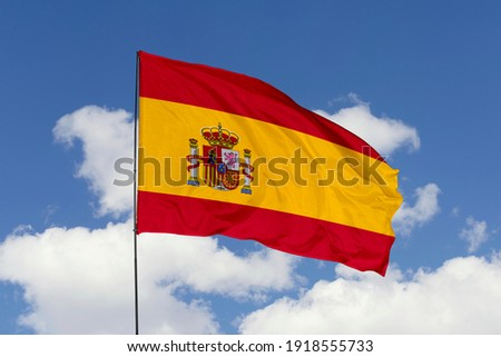 Spain flag isolated on the blue sky with clipping path. close up waving flag of Spain. flag symbols of Spain. ストックフォト ©