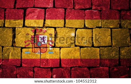 Spain flag painted on stone wall background - stock photo