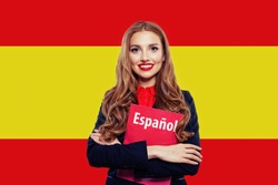 Spain. Happy student girl with red book against the spanish flag background. Travel and learn spanish language. Book with inscription Spanish on spanish language