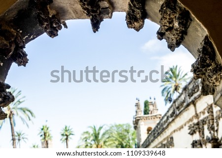 Spain, Seville, LOW ANGLE VIEW OF HISTORIC BUILDING AGAINST CLEAR SKY viewed through an arch, Europe #1109339648