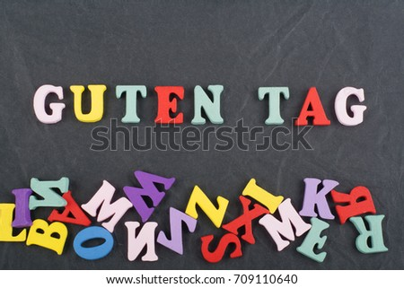 SPAIN word on black board background composed from colorful abc alphabet block wooden letters, copy space for ad text. Learning english concept