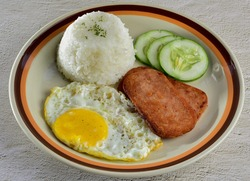 Spam Silog : a popular fast food in the Philippines that comes with rice and egg. Spam Silog is a Spam and etlog (egg in Filipino)