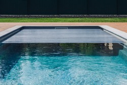 Span for pool. Rolling coating. Pool protection. Rollete.  Security. Pure water.  Pool protection system.