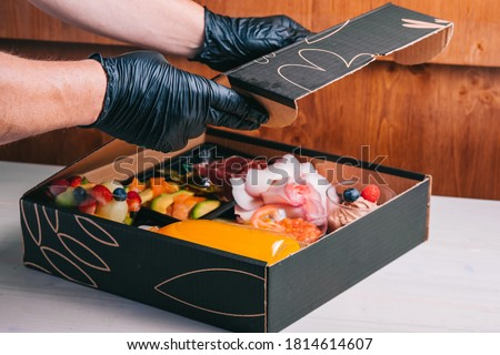 Spanish breakfast set with delivery salmon, Iberian ham, cheese orange juice in a cardboard box safe delivery Photo stock ©
