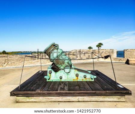 Spanish bronze alloy colonial cannon in old Spanish fort at the Castillo San Marcos, in historic Saint Augustine, Florida, USA, is one of the oldest America city #1421952770