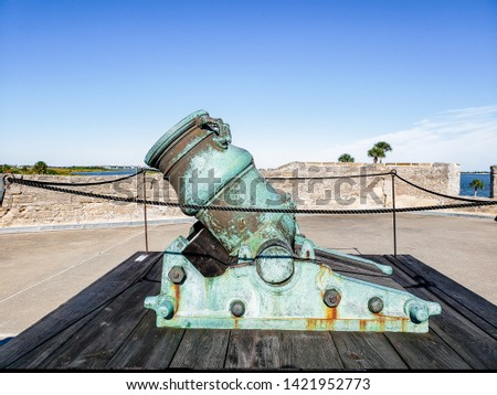 Spanish bronze alloy colonial cannon in old Spanish fort at the Castillo San Marcos, in historic Saint Augustine, Florida, USA, is one of the oldest America city #1421952773