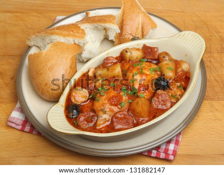 Spanish chicken casserole with chorizo, new potatoes and olives.