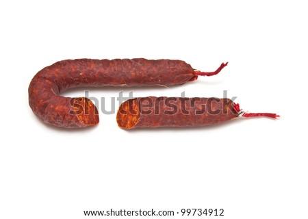Spanish Chorizo sausage isolated on a white studio background.