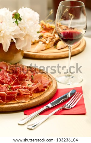 Spanish cuisine on the table and a glass of wine