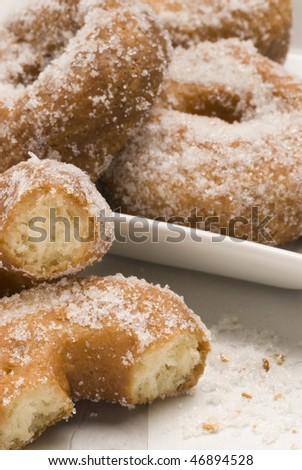 Spanish cuisine.Plate of sweet fritters. Lent doughnuts. Selective focus. Bunuelos de Cuaresma.