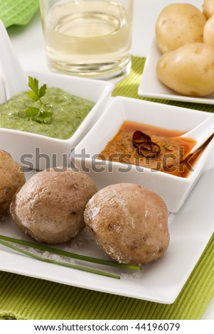 spanish cuisine red mojo sauce and green mojo sauce with wrinkled potatoes served in a white. Black Bedroom Furniture Sets. Home Design Ideas