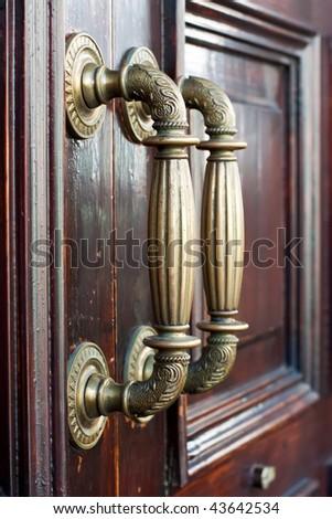 Spanish Decorative Old Knocker On Wooden Door #43642534