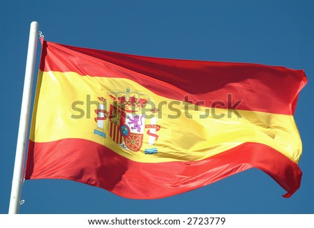 Spanish flag waving to the wind against the sky