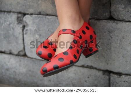Spanish flamenco red dance shoes - crosslegged girl