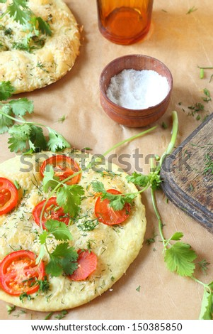 Spanish focaccia with tomatoes and herbs, top view