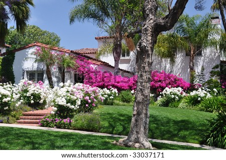 Spanish House with Pink and White Blooming Flowers
