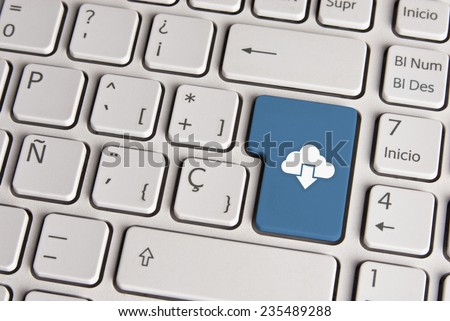 Spanish keyboard with technology cloud download icon over blue background button. Image with clipping path for easy change the key color and editing.
