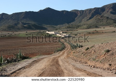 Spanish landscape. Desolate rural area in mountains of Andalusia. Agave plants. Cabo de Gata natural park near Almeria.