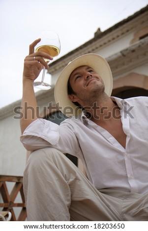 Spanish lifestyle man with white wine - stock photo
