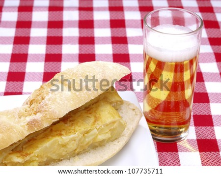 Spanish omelet. Spanish omelet, �Tortilla de patatas�, made with potatoes, eggs, olive oil, and salt...  It is eaten as starter, main dish, snack or for breakfast. Served on dish or as sandwich.