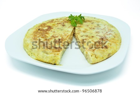 Spanish potato omelet on a dish on white background