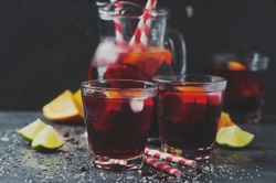 Spanish sangria with orange and lime, selective focus and toned image