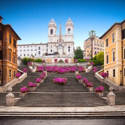 Spanish Steps in the morning with azaleas in Rome, Italy. Rome Spanish Steps (Scalinata della Trinità dei Monti) are a famous landmark and attraction of Rome and Italy.