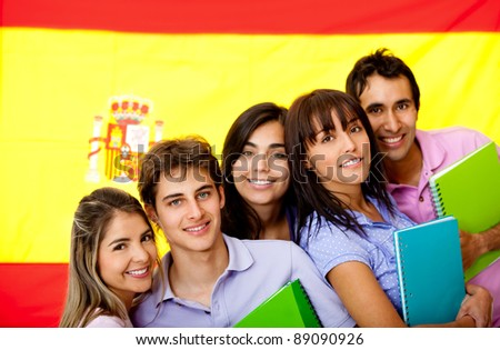 Spanish students with the flag of Spain at the background