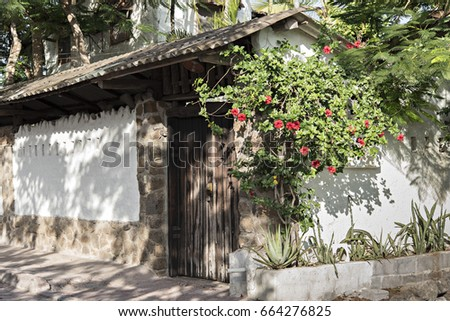 spanish style adobe house with...