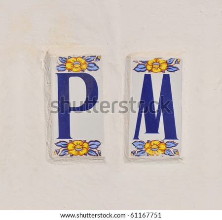 spanish style ceramic tile letters on white painted cement With spanish ceramic letter tiles