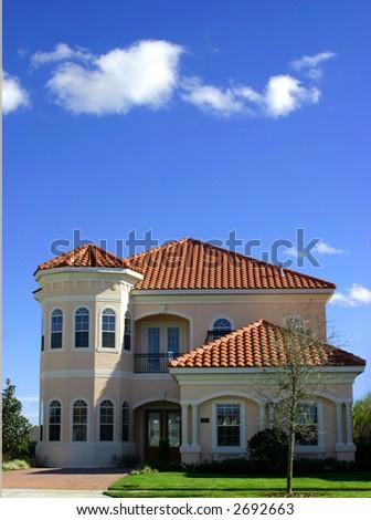 spanish style home against blue sky