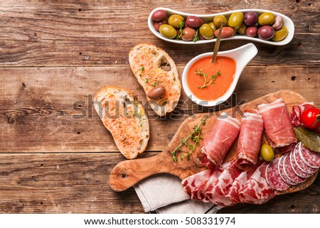 Shutterstock spanish tapas and red wine on wooden table, top view