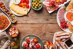 spanish tapas and sangria on wooden table, top view with copy space