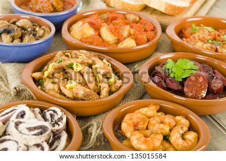 Spanish Tapas & Crusty Bread - chorizo al vino, gambas pil pil, patatas bravas, albondigas a la jardinera, setas al ajillo, pollo al limon con ajo, rollitos de pollo con aceitunas, tomates al ajillo