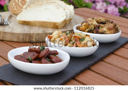 Spanish Tapas - Hot & Spicy Spanish appetisers. (chorizo al vino, gambas pil pil and pollo al ajillo). Served with Mediterranean bread.