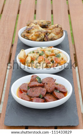 Spanish Tapas - Hot & Spicy Spanish appetisers (chorizo al vino, gambas pil pil and pollo al ajillo).