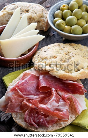 spanish tapas, iberian ham, manchego cheese and olives