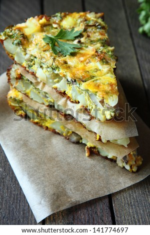 Spanish tortilla with slices of fresh greens food