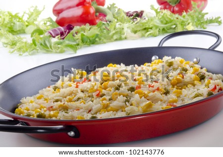 spanish vegetable paella with bell pepper, sweet corn and pea