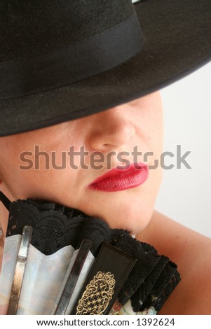 Spanish woman with hat and fan