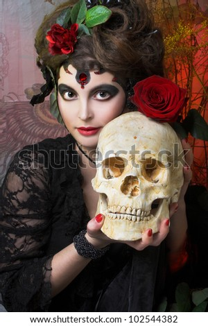 Spanish woman. Young woman in dramatic artistic image with rose's and skull