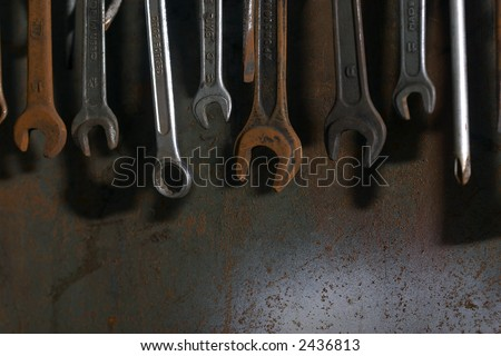 spanner set on the rusty background