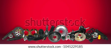 Spare parts car on the red background set. Many auto parts are located on the edge of the image. OEM parts, auto parts for customer.