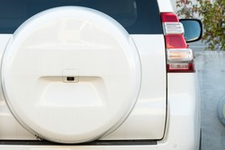 spare wheel cover on a white overland or 4x4 vehicle closeup concept motor car industry
