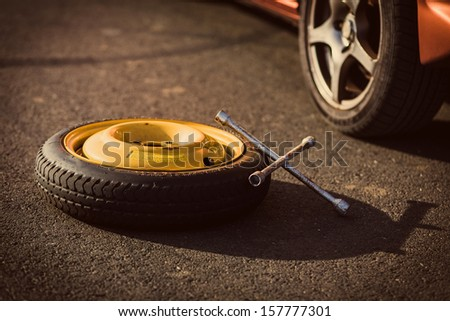 Spare wheel of a car with tool