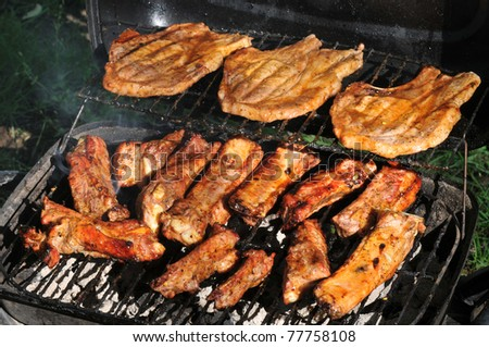 Spareribs and Grilled steaks on the grill