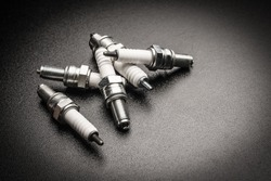 Spark plugs on black background . car and motorcycle part