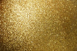 Sparkle glowing dark gold glitter of carborundum abstract textured background, can use for celebrate christmas day, new year day or birthday