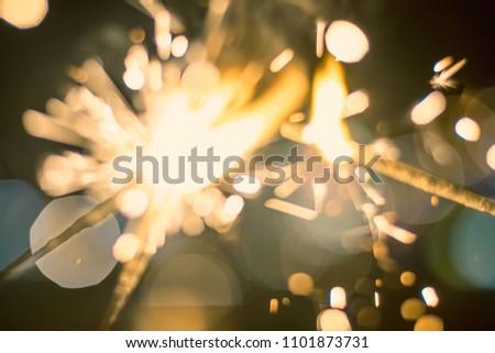 Sparkler Bokeh Colorful sparkler. Night background with a sparkler.  #1101873731